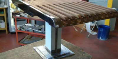 tavolo allungabile in inox e tek
